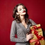 Woman holding gifts with red lipstick on